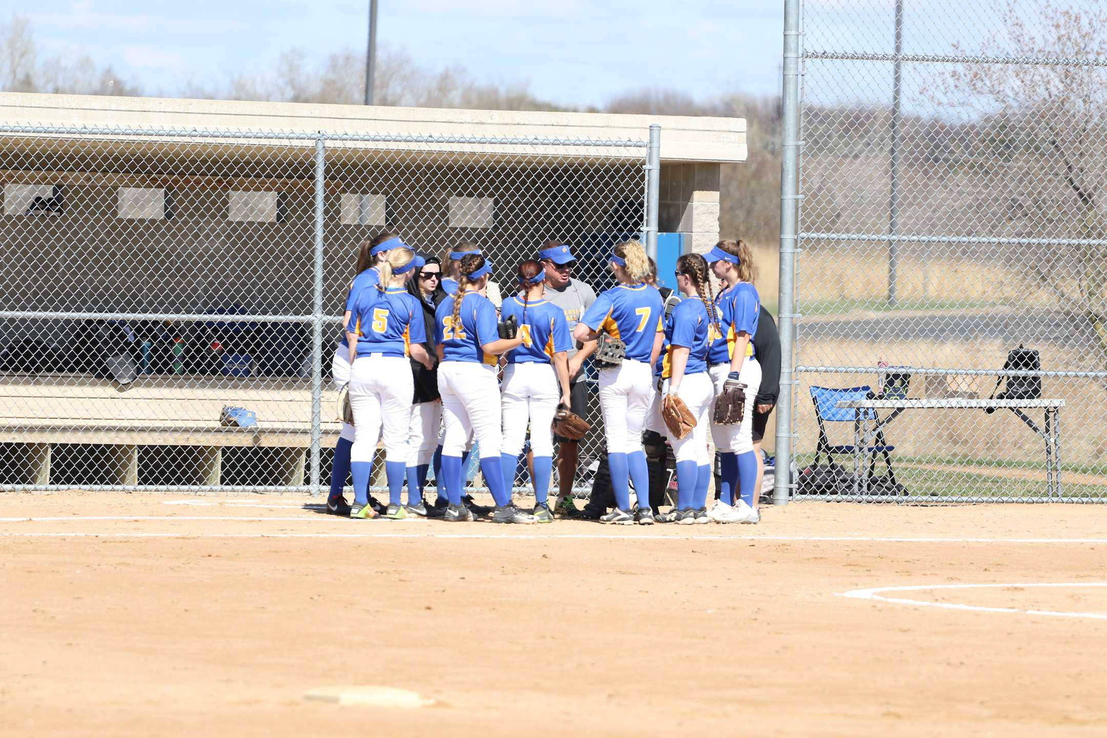 Women's softball plays at Cambridge campus. Photo Credit: ARCC Golden Rams