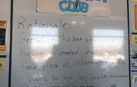 Students continued a heated discussion about inclusion on the whiteboard.  Photo Credit: Jack Yates