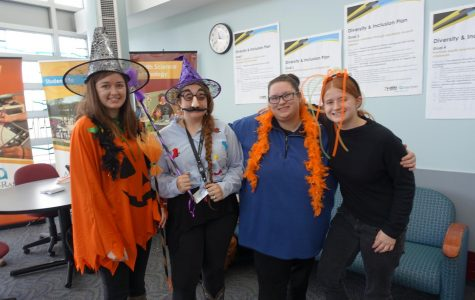 (Left to right) Caitlin Funder, Victoria Schumann, Angela Krieger and Mercedes Wilson had some fun with the costume try-on game.