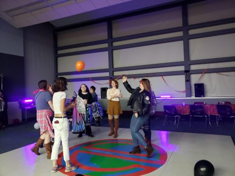 There were many balloons decorating the dance floor, and students hit them up into the air.