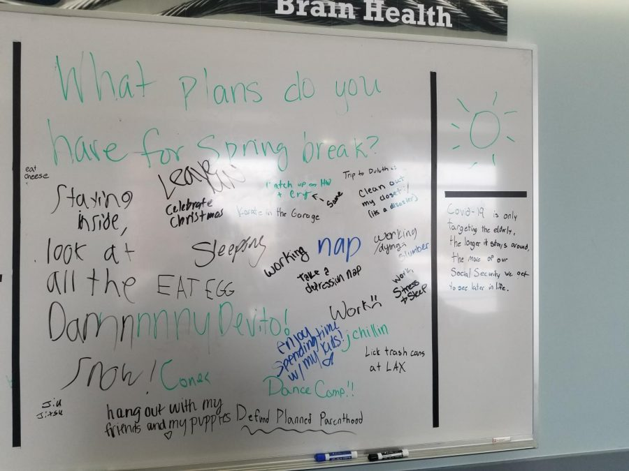 This recent picture of the whiteboard from March shows that students have written questionable and irrelevant content, including a statement about defunding Planned Parenthood and false information about the Covid-19 outbreak. Image Credit: Yuri Malik